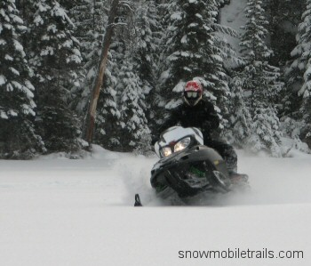 Snowmobiling in powder Plummes Lake, Ontario